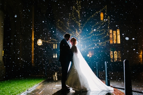 Manchester museum wedding photography. Backlit snow winter wedding